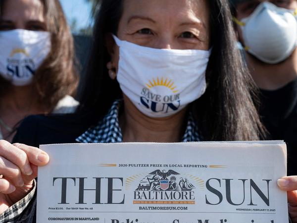 <em>Baltimore Sun</em> reporter Jean Marbella participates in a Save Our Sun rally in March, part of an effort to secure an alternative buyer to Alden Global Capital.