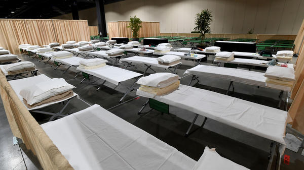 Sleeping quarters set up for migrant children are shown during a tour of the Long Beach Convention Center on April 22. Long Beach officials and officials with the U.S. Department of Health and Human Services led the tour.