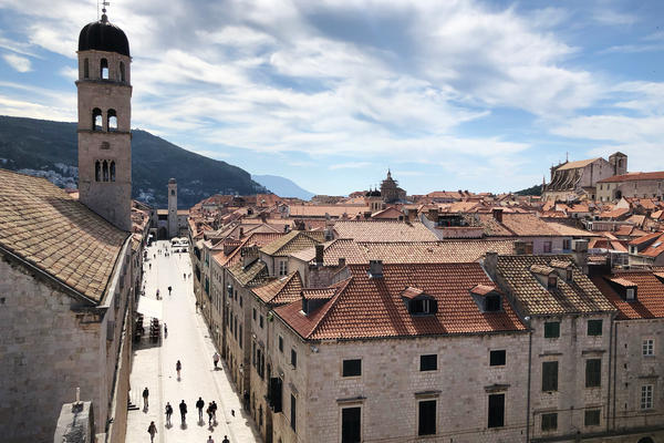 A view of Dubrovnik's old town from atop the ancient city wall. Few people are in the ancient town that's usually packed with tourists in the spring.