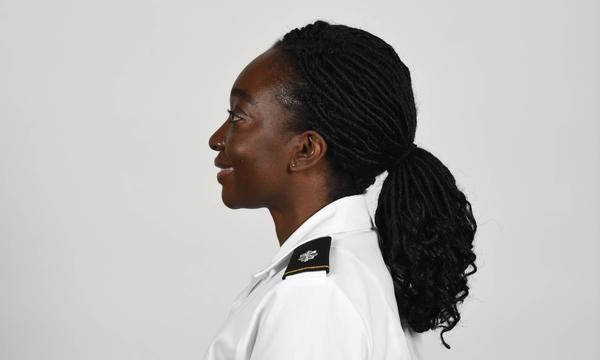 An Army photo shows a soldier wearing a new approved ponytail hairstyle.