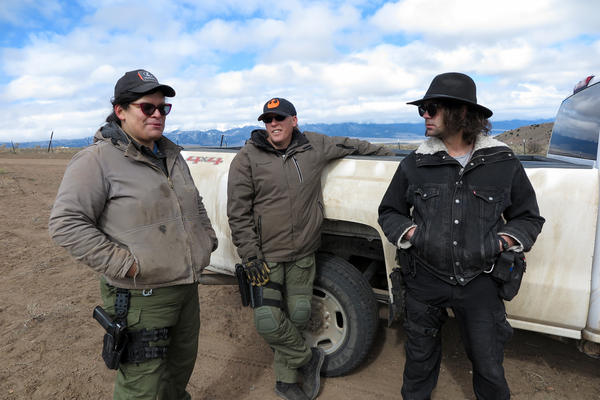 Tenacious Unicorn Ranch owners Bonnie Nelson and Penny Logue discuss heightened security measures on their property with ranch member J Stanley on April 28.