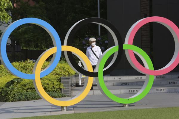 The International Olympic Committee plans to implement strict virus-prevention measures that include segregation of athletes from the general population and a ban on overseas fans.