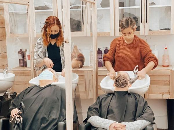 Two clients get their hair shampooed at Good. Co. Salon & Spa. Owner Emily Anderson says the salon is booked for the summer and everybody is busy each day.
