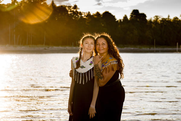 Danita Bilozaze, alongside her daughter Dani, celebrated the completion of her master's degree in education with a portrait session last year at Kye Bay in the Comox Valley, British Columbia. Bilozaze's studies focused on Indigenous language revitalization.