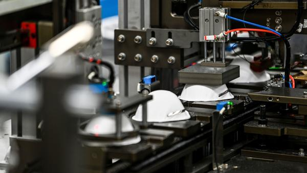 A machine makes masks in a medical-equipment factory in the U.S. on Feb. 15. When an N95 respirator shortage left hospitals scrambling in 2020, U.S. manufacturers stepped in. Now, some of those companies are struggling to sell their masks.