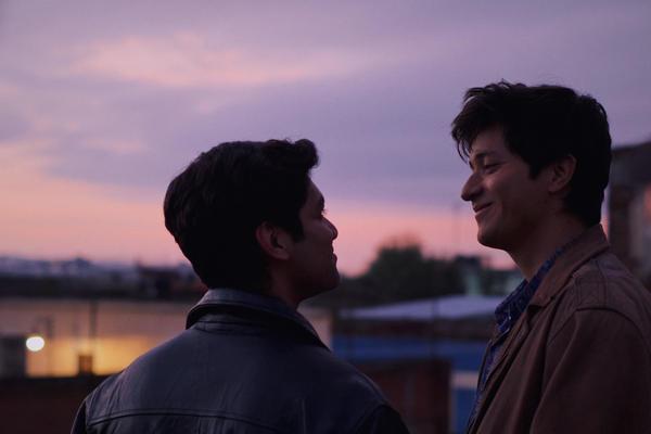 Christian Vázquez as Gerardo and Armando Espitia as Iván in <em>I Carry You with Me.</em>