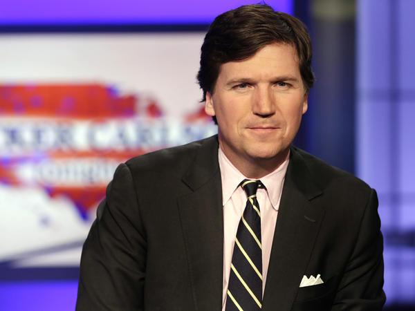 Tucker Carlson, host of <em>Tucker Carlson Tonight</em>, on the set of his Fox News program in 2017.