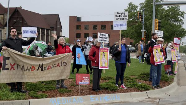 Advocates for expanding Medicaid in Kansas staged a protest outside the entrance to the statehouse parking garage in Topeka in May 2019. Today, twelve states have still not expanded Medicaid. The biggest are Texas, Florida, and Georgia, but there are a few outside the South, including Wyoming and Kansas.