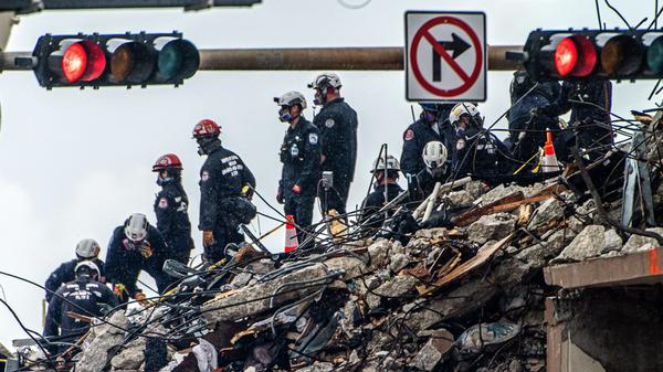 Search and rescue teams look for possible survivors in the partially collapsed 12-story Champlain Towers South condo building on Wednesday in Surfside, Fla.