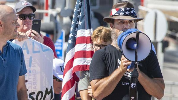 Alan Hostetter, seen here in May 2020, became a leading activist against coronavirus-related lockdown policies in Orange County, Calif. Hostetter, a former police chief and yoga instructor, is now facing conspiracy charges for his alleged role in the insurrection at the U.S. Capitol.