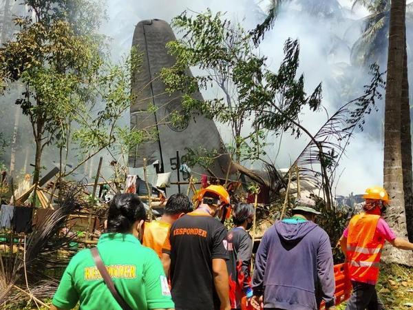 Rescuers search for bodies from the site where a Philippine military C-130 plane crashed in Patikul town, Sulu province, southern Philippines on Sunday.