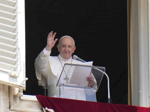 Pope Francis waves to the crowd from the window of his studio overlooking St.Peter's Square, at the Vatican. In a brief announcement Sunday afternoon the Vatican said Pope Francis has gone to a Rome hospital for scheduled surgery.