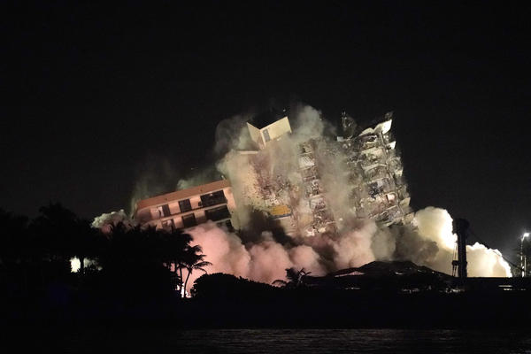 The remaining structure of the Champlain Towers South condo building was demolished on Sunday night, in Surfside, Fla., more than a week after it partially collapsed.