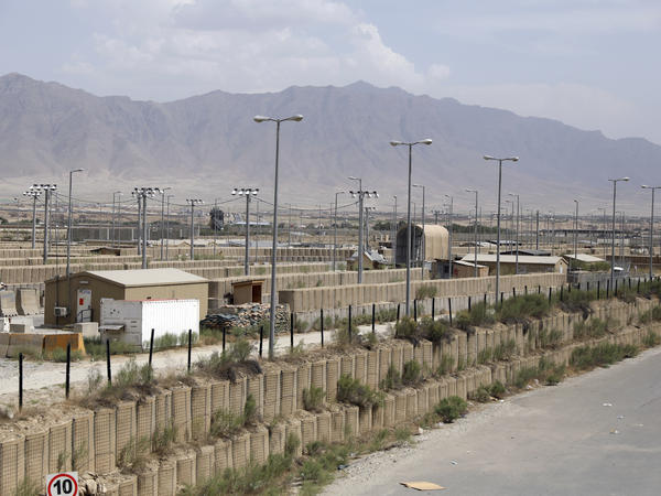 Blast walls and a few buildings can be seen Monday at Bagram Airfield after the U.S. military left the Afghan base in Parwan province north of Kabul.