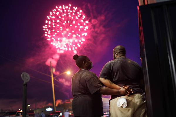 People gather along Main Street to watch fireworks while celebrating Independence Day on July 04, 2021 in Sweetwater, Tennessee.