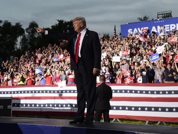 Former President Donald Trump has announced that he is suing three of the country's biggest tech companies: Facebook, Twitter and Google's YouTube. Here, he walks onstage during a rally on July 3 in Sarasota, Fla.