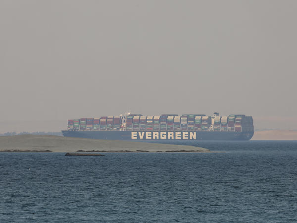 The Ever Given, a Panama-flagged cargo ship, is seen in Egypt's Great Bitter Lake in late March. An Egyptian court  has lifted a three-month long judicial seizure of the hulking shipping vessel, which blocked the Suez Canal for nearly a week earlier this year.