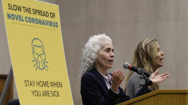 Los Angeles County Public Health Director Barbara Ferrer, left, takes questions at a news conference on March 12, 2020.