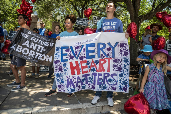 Anti-abortion-rights protesters come out in May to the Texas Capitol in Austin in response to a bill that Gov. Greg Abbott signed outlawing abortions after a fetal heartbeat is detected.
