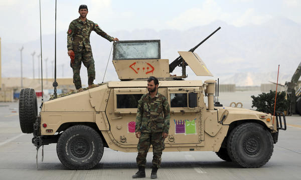 Afghan soldiers stand guard after the American military left the Bagram Airfield, north of Kabul, on July 5. While the U.S. military is now largely gone from Afghanistan, the CIA is still monitoring the Taliban and developments in the country, though under much more difficult circumstances.