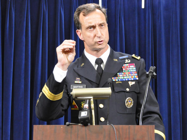 Army Brig. Gen. Mark Martins, Guantánamo's chief prosecutor, addresses the media on Oct. 19, 2012, at the end of a week of pretrial hearings for the five alleged architects of the 9/11 attacks. Martins announced his retirement this week.