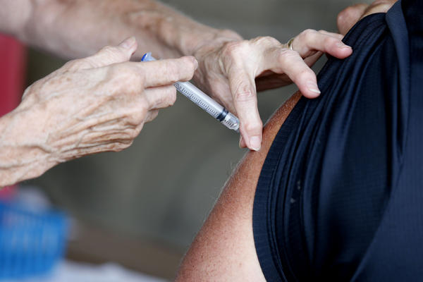 A man receives a COVID-19 vaccine at a clinic in Springfield, Mo., in June. Vaccination rates in southern Missouri are low, a factor officials say is helping drive what's now the nation's largest outbreak.