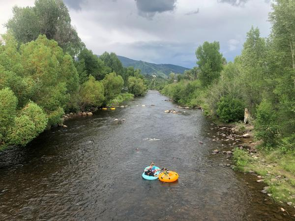 Tubers float the Yampa River through downtown Steamboat Springs on July 1. Thousands of tourists travel to this mountain town each year to visit the river.