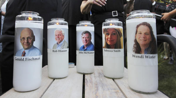 Five employees of the <em>Capital Gazette</em> newspaper are honored across the street from the newsroom where they were killed in Annapolis, Md.