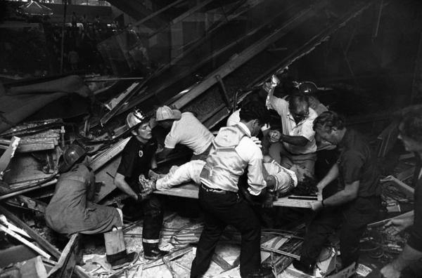 Firefighters rescue people from under a collapsed walkway in the lobby of the Hyatt Regency Hotel in Kansas City, Mo., on July 17, 1981. The collapse killed 114 people and injured more than 200.