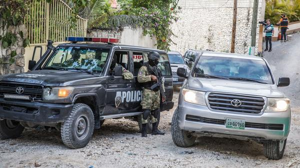 Police stand guard Thursday outside the residence of the late Haitian President Jovenel Moïse in Port-au-Prince after his assassination last week.