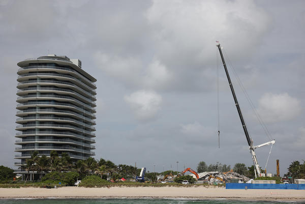 Cranes are operated over the remains from the collapsed 12-story Champlain Towers South condo building on July 9 in Surfside, Fla.