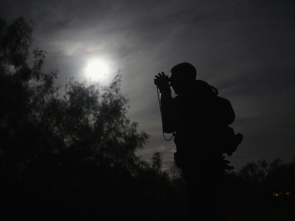 A U.S. Border Patrol agent uses night vision goggles near Roma, Texas in August 2016. More than 100 such devices have gone missing from the Fort Hood Army post near Killeen, Texas.