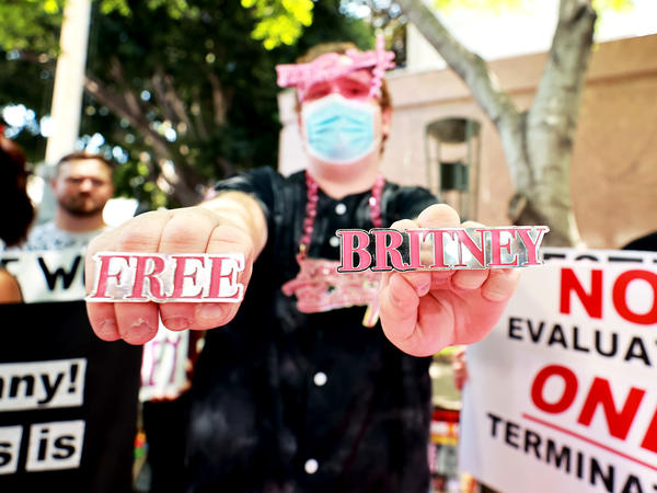 Protesters attend a #FreeBritney Rally at Stanley Mosk Courthouse on Wednesday in Los Angeles. The group is calling for an end to the 13-year conservatorship led by the pop star's father, Jamie Spears, who has control over her finances and business dealings.