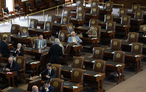 Empty seats are seen in the House Chamber at the Texas Capitol, Tuesday, July 13, 2021, in Austin, Texas. Texas Democrats left the state to block sweeping new election laws, while Republican Gov. Greg Abbott threatened them with arrest the moment they return.
