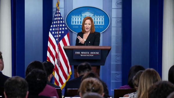 White House press secretary Jen Psaki speaks Tuesday at the daily briefing. She acknowledged a White House staffer had tested positive for the coronavirus despite being fully vaccinated. She said it wasn't the first breakthrough case.