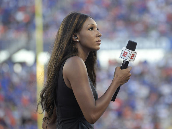 ESPN's Maria Taylor works from the sidelines during an NCAA college football game between Miami and Florida in 2019. ESPN announced Wednesday that Taylor is leaving the network.