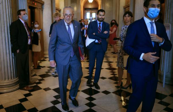 Senate Majority Leader Chuck Schumer, D-N.Y., walks off the Senate floor Wednesday during a procedural vote on the bipartisan infrastructure bill that ultimately failed.