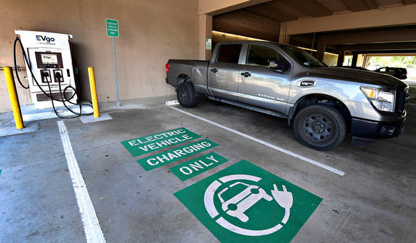 A space remains open for an electric vehicle at a EV charging station in Monterey Park, California on May 18, 2021. (Photo by Frederic J. BROWN / AFP) (Photo by FREDERIC J. BROWN/AFP via Getty Images)