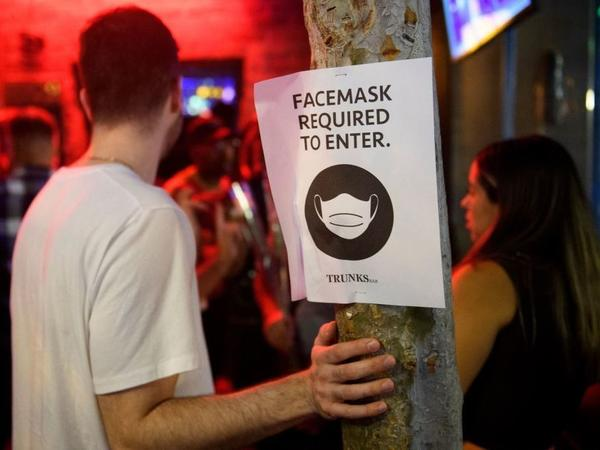 The Centers for Disease Control and Prevention hasn't budged on its guidance that vaccinated people can skip mask-wearing, but some local governments faced with surging cases are going back to mandates, such as Los Angeles County, which recently mandated indoor mask use, including at places like bars and restaurants.