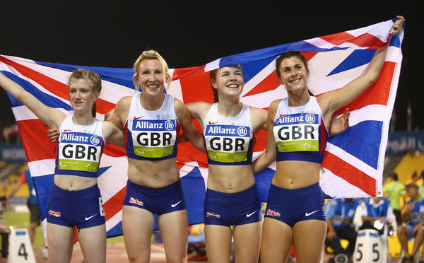 """Olivia Breen (right), a Welsh Paralympian seen here in 2015, recently recounted a competition official remarking that her briefs were """"too short and inappropriate."""" Here, she, along with Sophie Hahn (from left), Georgina Hermitage and Maria Lyle of Great Britain, celebrate winning gold in the women's 4x100m T35-38 relay final of the IPC Athletics World Championships in Doha, Qatar, in 2015."""