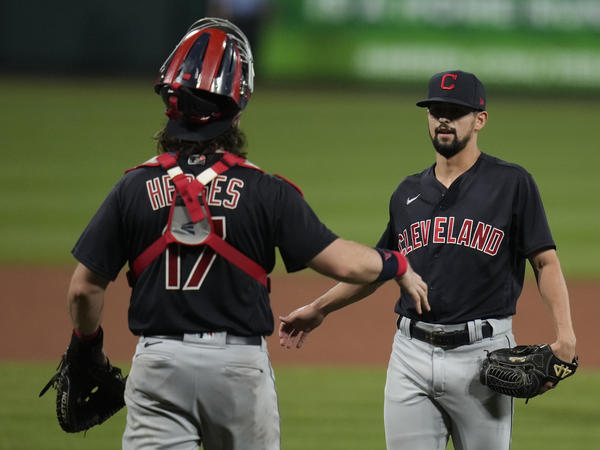 Cleveland relief pitcher Nick Sandlin (right) and catcher Austin Hedges celebrate a 10-1 victory over the St. Louis Cardinals on June 8. On Friday, the Cleveland team announced its new name, the Guardians.