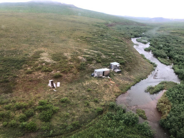 While flying over Alaska from Kotzebue to Nome, a Coast Guard aircrew spotted an SOS sign on top of a shack and a man waving his hands in the air.
