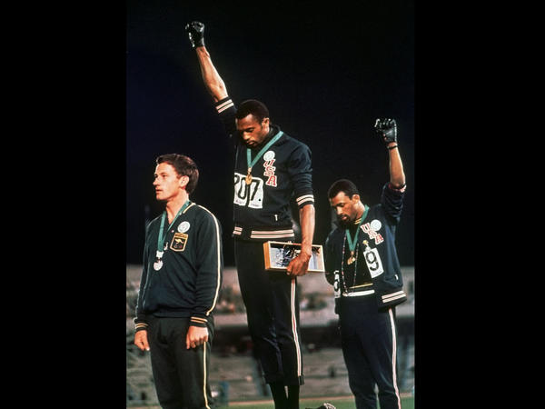 In a famous moment from the 1968 Summer Olympics in Mexico City, U.S. athletes Tommie Smith (center) and John Carlos raise their gloved fists after Smith received the gold medal and Carlos the bronze for the 200-meter run.
