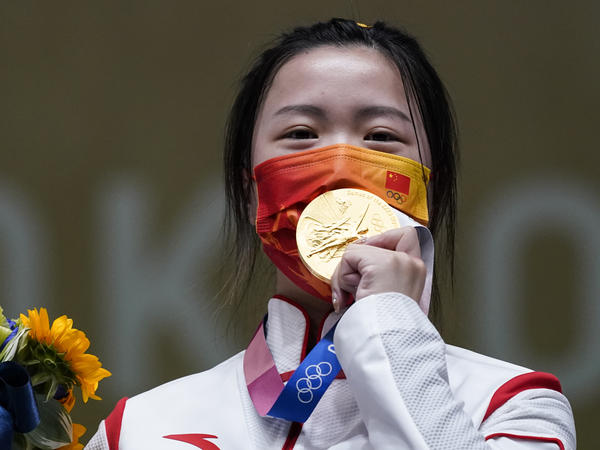 Qian Yang of China celebrates after winning the gold medal in the women's 10-meter air rifle at the Asaka Shooting Range in the Summer Olympics on Saturday.