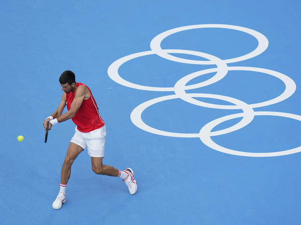 Serbia's Novak Djokovic practices for the men's tennis competition on Thursday at the Summer Olympics.