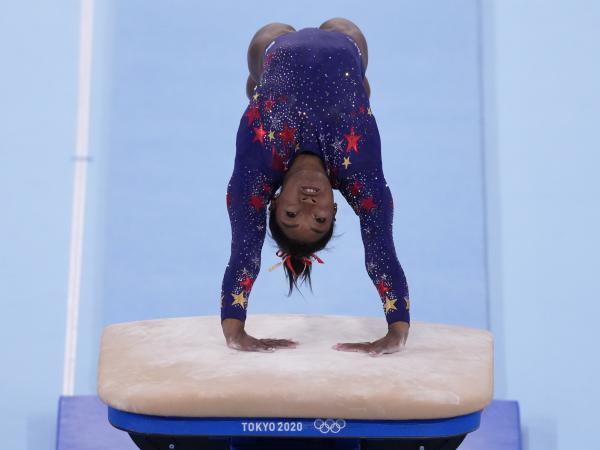 U.S. gymnastics star Simone Biles performs on the vault during the women's artistic gymnastic qualifications on Sunday at the 2020 Summer Olympics in Tokyo.
