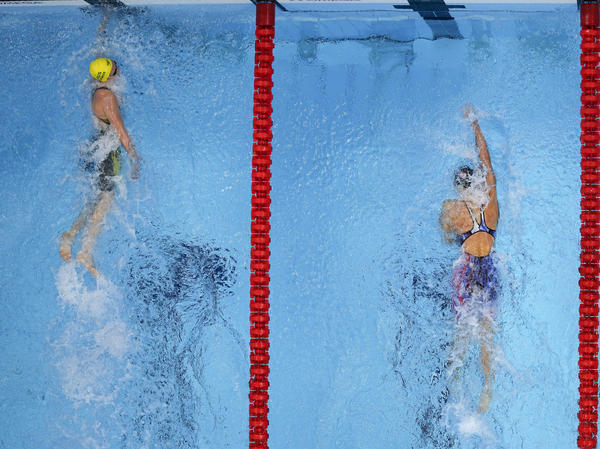 Ariarne Titmus (left) of Australia wins the final of the women's 400 meter freestyle on Monday ahead of the U.S.'s Katie Ledecky at the Summer Olympics in Tokyo.