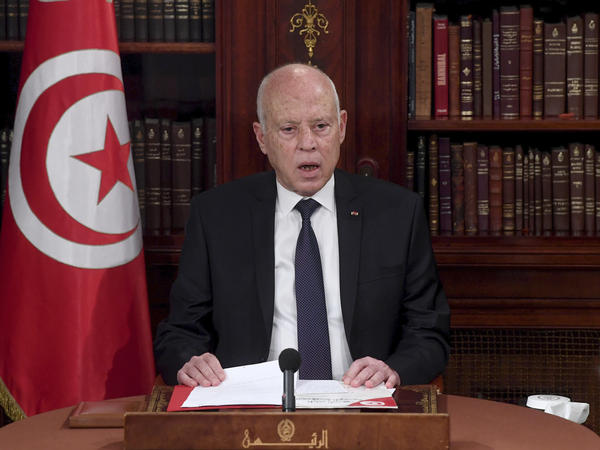 Tunisia's President Kais Saied leads a security meeting with members of the army and police forces in Tunis, Tunisia, on Sunday. Troops surrounded the parliament building and blocked its speaker Rached Ghannouchi from entering Monday after the president suspended the legislature and fired the prime minister following nationwide protests.
