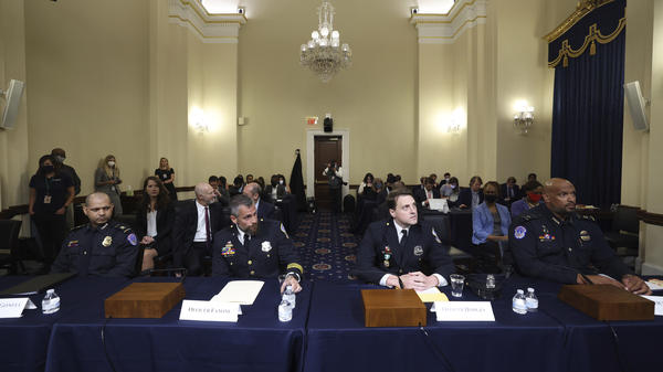 From left: U.S. Capitol Police officer Aquilino Gonell, Washington Metropolitan Police Department officer Michael Fanone, Washington Metropolitan Police Department officer Daniel Hodges and U.S. Capitol Police officer Harry Dunn arrive to testify at the House select committee hearing on the Jan. 6 attack on Capitol Hill on Tuesday.