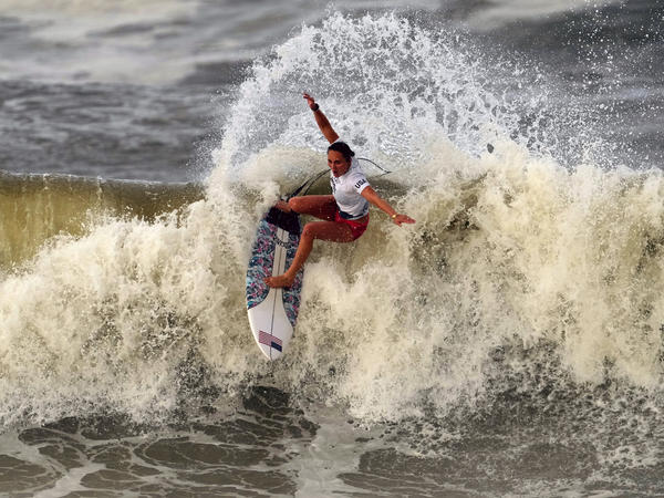Carissa Moore from the U.S. performs on the wave during the gold medal heat in the women's surfing competition at the Summer Olympics on Tuesday in Ichinomiya, Japan.